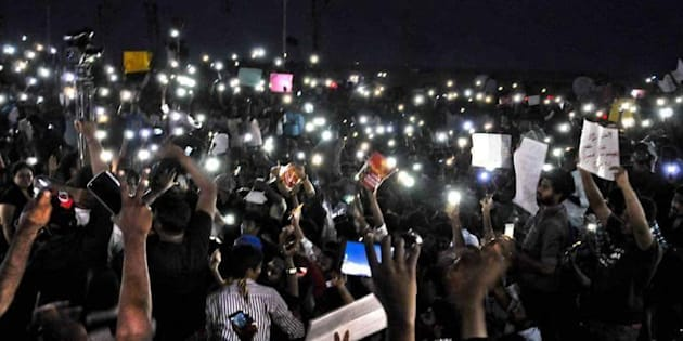 Hundreds of protestors at Chennai's Marina beach hold up their mobile phones while protesting against the ban on Jallikattu on Tuesday night, 17 January, 2017.