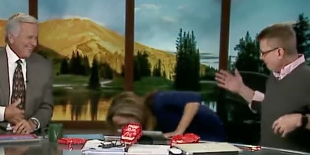 """Natalie Tysdal, morning news anchor for Denver's KWGN-TV, throws up after attempting the chip company Paqui's """"One Chip Challenge"""" where participants eat a chip coated with Carolina Reaper peppers on Wednesday."""
