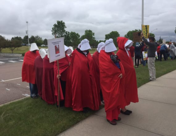 'Handmaids' protest Pence in Colorado Springs