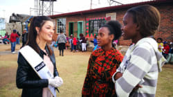 Miss SA Explains Herself After Being Called Racist For Wearing Gloves While Feeding Black