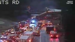 Les premières images du déraillement d'un train tombant sur une autoroute aux