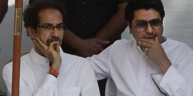 File photo of Maharashtra Navnirman Sena (MNS) chief Raj Thackeray (R) with Shiv Sena chief Uddhav Thackeray.