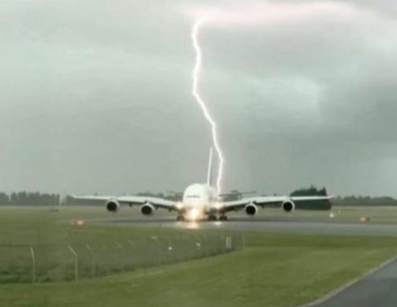 Moment lightning strikes nearly plane
