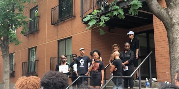 Demonstrators hold a protest outside the apartment where Pierre Coriolan was shot dead by police in Montreal.