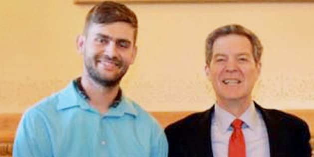 File photo of Kansas Governor Sam Brownback with Ian Grillot.