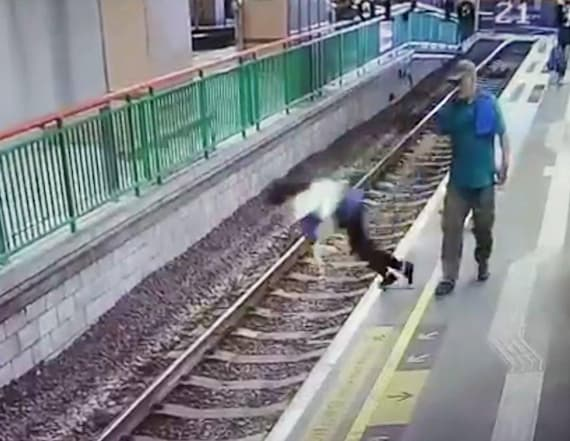 SEE IT: Man shoves woman onto train tracks