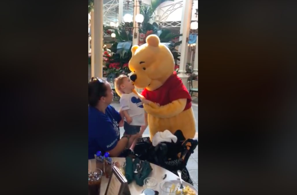 b7ffe5aac Winnie the Pooh spent 10 minutes comforting a disabled little boy at Disney  World, and the video will break your heart