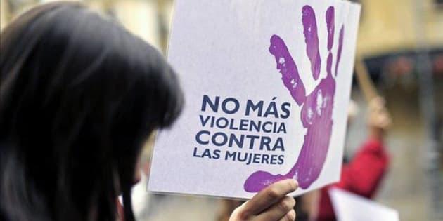 Imagen de una mujer en una protesta contra la violencia machista.