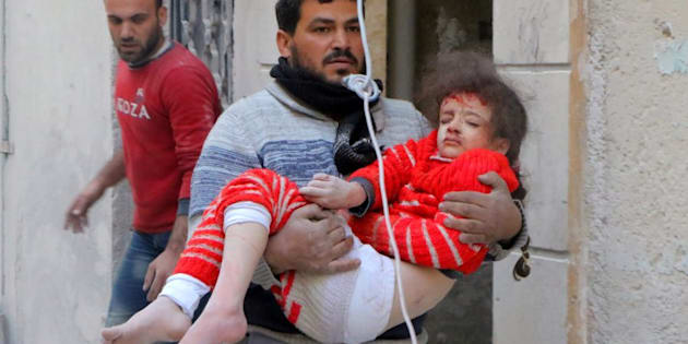 ALEPPO, SYRIA - NOVEMBER 22: A resident carries a wounded child girl pulled out of a debris after the air strikes carried out by the war crafts belonging to Assad regime forces on the opposition-controlled Al Moyaser neighbourhood of Aleppo, Syria on November 22, 2016.