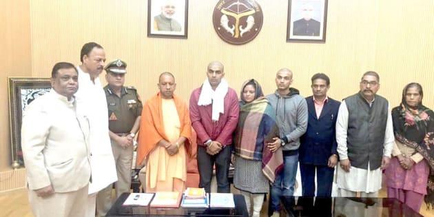 Yogi Adityanath with Inspector Subodh Singh's family.