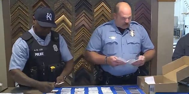 Officers from Kansas City, Kansas Police Department collecting business cards to give to a family of a late police officer from Iowa on Oct. 25, 2017.