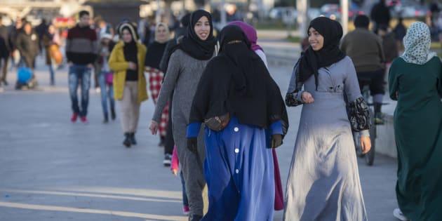 Moroccan women walking in the capital Rabat.