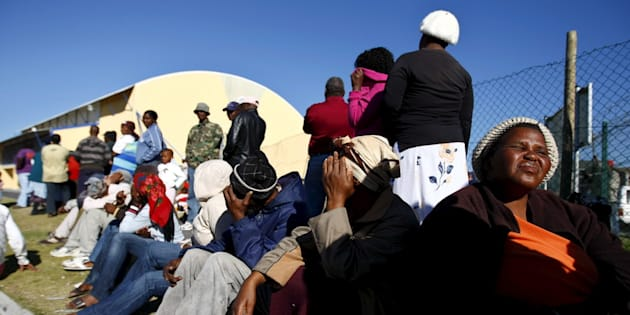 People queue to register for government grants in Cape Town, South Africa.