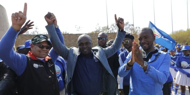 Solly Msimanga, centre, the mayor of Tshwane, with Democratic Alliance national leader, Mmusi Maimane, right, celebrate winning the city in 2016.