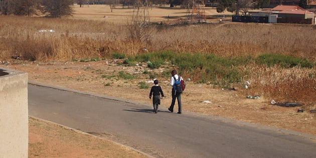 Children across South Africa often walk long distances to school and back.