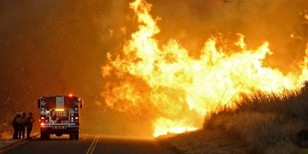 A fire crew takes shelter behind an engine as the Sherpa Fire advances at El Capitan State Beach in Santa Barbara, California, U.S. in this handout photo released to Reuters June 16, 2016. Ron Eliason/Santa Barbara County Fires Department/Handout via Reuters ATTENTION EDITORS - THIS IMAGE WAS PROVIDED BY A THIRD PARTY. EDITORIAL USE ONLY. TPX IMAGES OF THE DAY