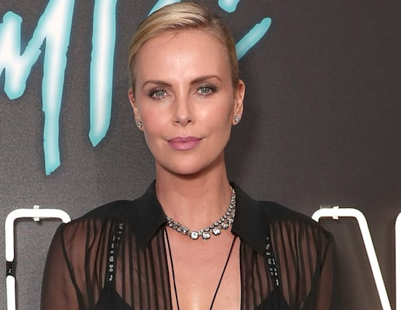Charlize Theron flashes her bra in sheer top