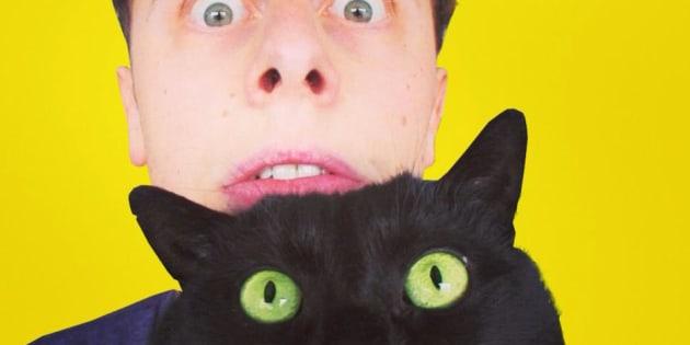 Norman et son chat Sergi
