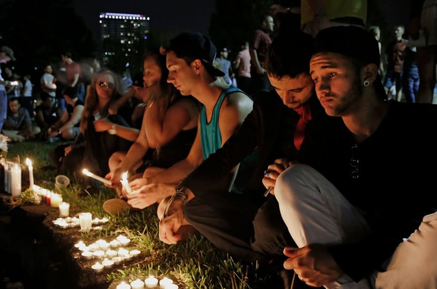 ORLANDO, FL - JUNE 12: Johnpaul (one word) Vazquez, right, and his boyfriend Yazan Sale, sit by Lake Eola, in downtown Orlando thinking of those killed and injured. 'We were supposed to go to the club last night, but I didn't feel right,' said Vazquez. Fifty people were killed and more than 50 others injured in a mass shooting at Pulse nightclub, located at 1912 S. Orange Ave., Orlando, Florida in the worst mass shooting in American history. Twenty-year-old Omar Mateen of Port St. Lucie, identified as the shooter. (Photo by Carolyn Cole/Los Angeles Times via Getty Images)
