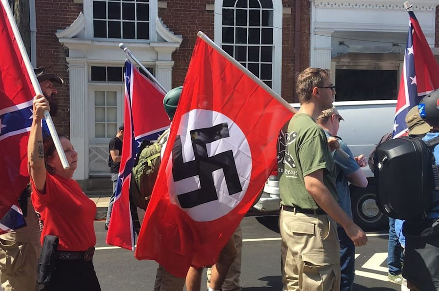 Demonstrators hold Confederate and Nazi flags in Charlottesville, Virginia.