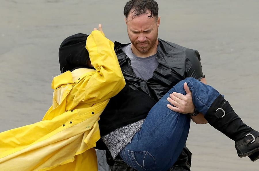 HOUSTON, TX - AUGUST 29: A volunteer carries a woman whose home was impacted by severe flooding following Hurricane Harvey in north Houston August 29, 2017 in Houston, Texas. Parts of southeast Texas have received more than 40 inches of rain since Harvey made landfall on Friday, with more torrential rain expected the next several days. (Photo by Win McNamee/Getty Images)