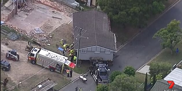 The 26-year-old became wedged between the house and the removalist truck.