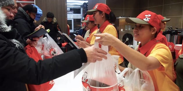 Staff at a Jollibee location in Winnipeg, in a picture posted to Jollibee's Facebook page, Dec. 15, 2016.