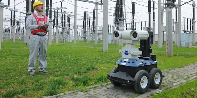 CHUZHOU, CHINA - JUNE 06:  (CHINA OUT) Two robots inspect the equipment in a 220kV electrical substation on June 6, 2016 in Chuzhou, China. The robots possess an infrared thermal imager and a visual light camera, thereby giving them the ability to replace 24-hour manual inspection. With the arrival of the national college entrance exam, Chuzhou's power company uses the robots to improve efficiency, ensure quality and guarantee the safety of the power supply during the exam period.  (Photo by VCG/VCG via Getty Images)