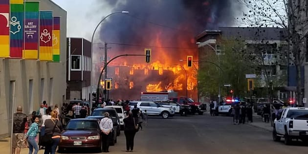 A building in downtown Brandon, Man. is engulfed in flames on May 19, 2018.