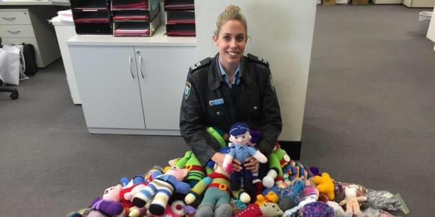Leading Senior Constable Emma with the Trauma Teddies.