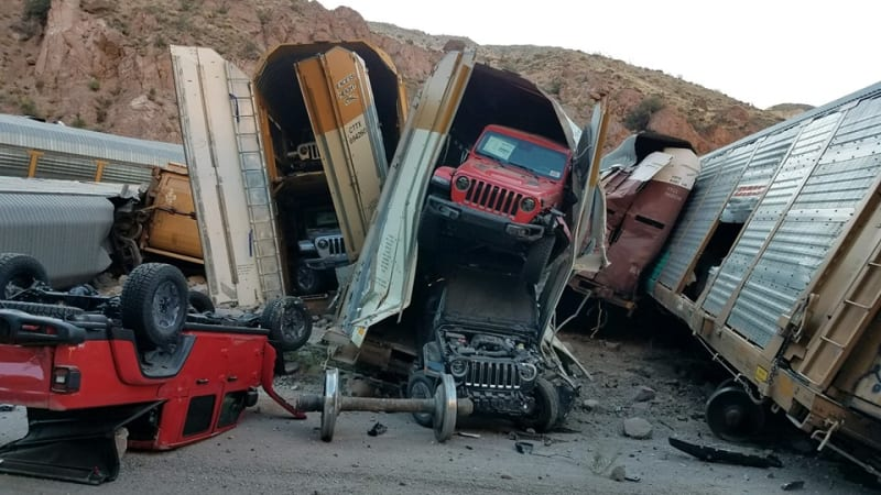 Train derailment leaves Jeep, GMC, Chevy pickups damaged in