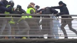 Un policier roué de coups par des gilets jaunes en direction de l'Assemblée
