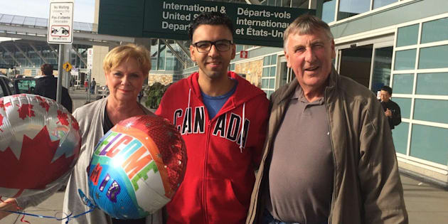 Amir (centre) with Wayne and Linda Taylor, after arriving in Canada