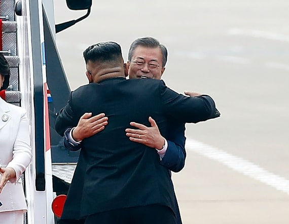 Kim Jong Un hugs South Korean leader