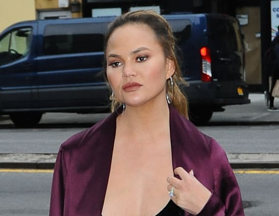 Chrissy Teigen bares cleavage in plunging top