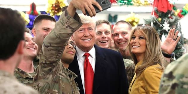 President Donald Trump makes surprise Christmas visit to troops in Iraq in first trip to combat zone (ABC News)