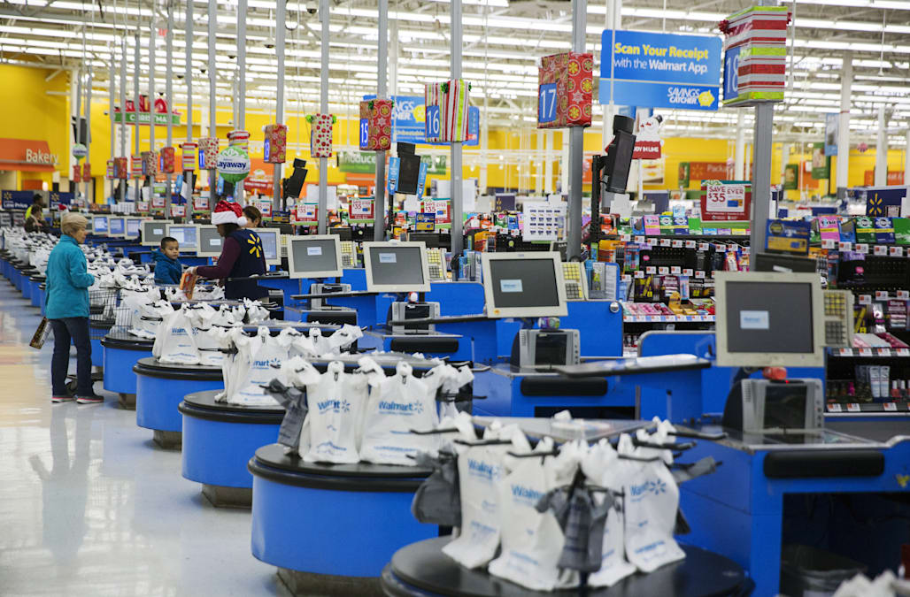 a78163161f1 Walmart is testing a new dress code that allows employees to wear blue  denim and shirts of any solid color.