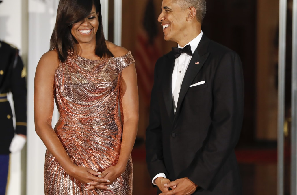 obama dazzles in metallic versace gown at state