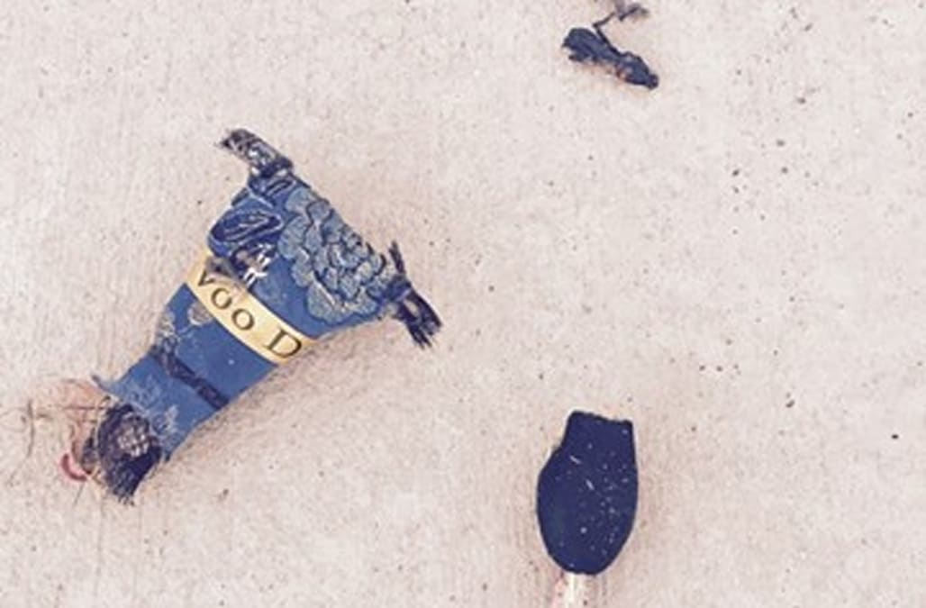 Mystery surrounds beheaded voodoo doll found in front of police