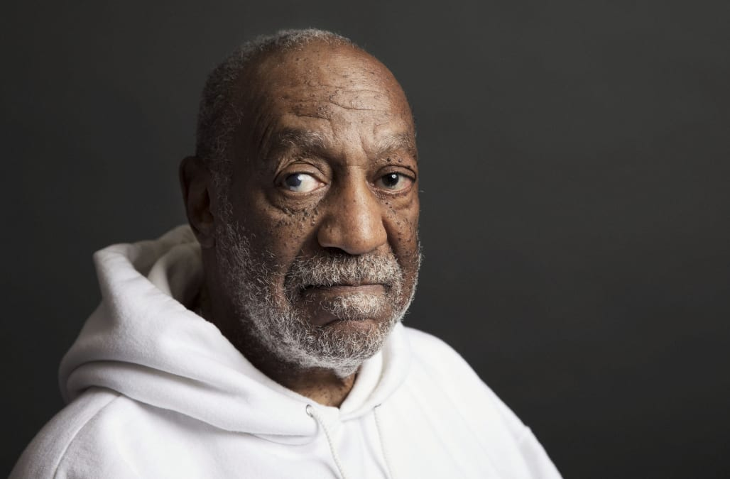 Body language expert says Bill Cosby's mugshot is 'the