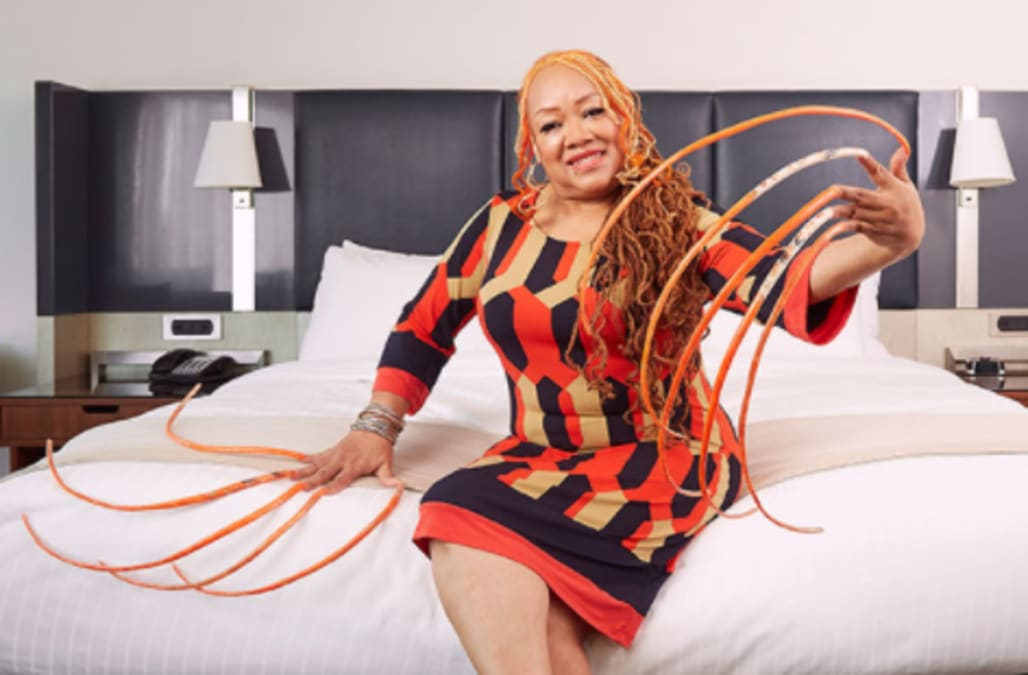 Woman breaks records with her 18-foot-long fingernails - AOL Lifestyle