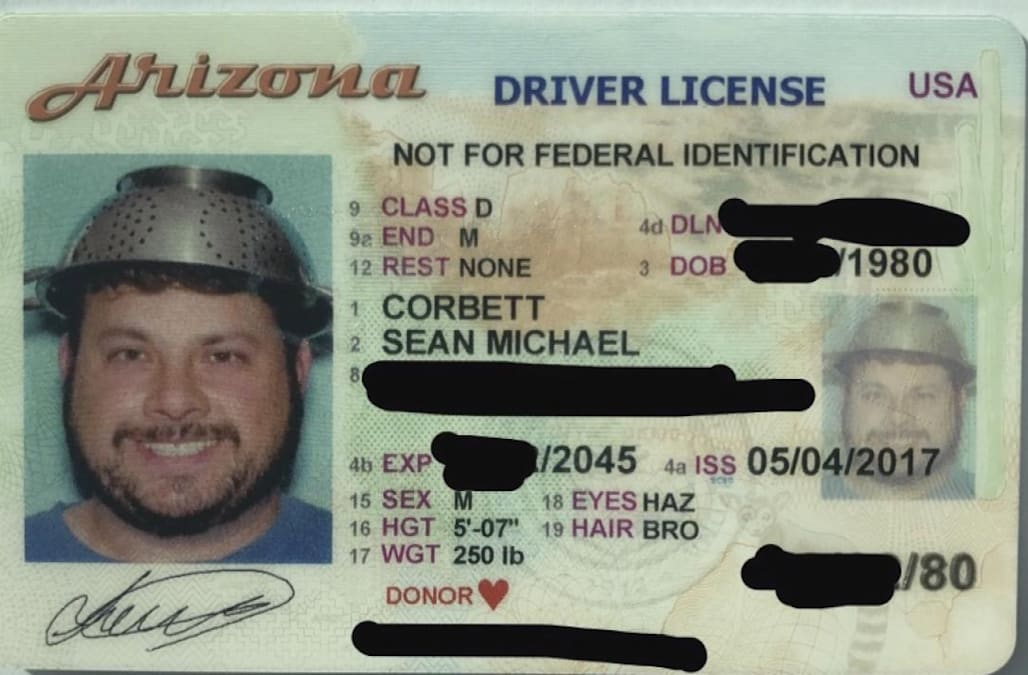 Image result for Arizona man gets approval to wear pasta strainer on his head in driver's license photo