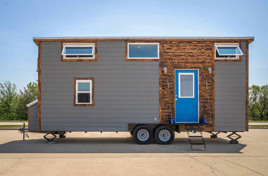 This tiny house boasts a walkin closet and home office in under