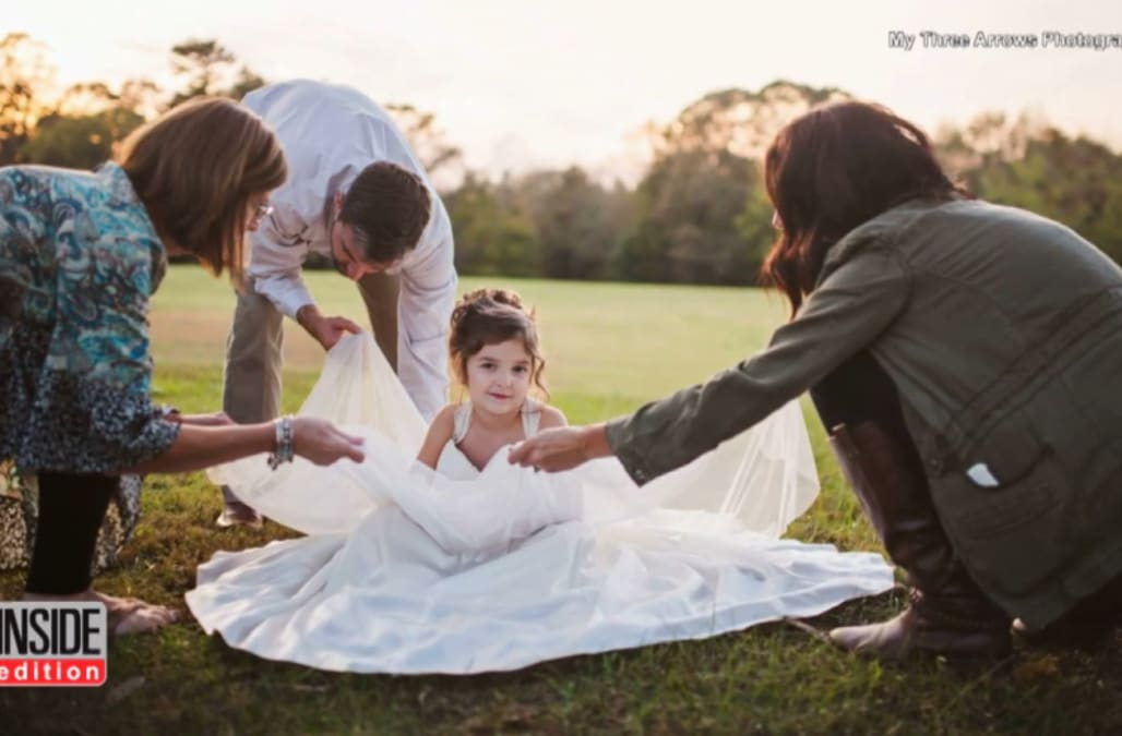 0d11a0e85b4 4 year old wears her late mom s wedding dress for a photo shoot - AOL  Lifestyle