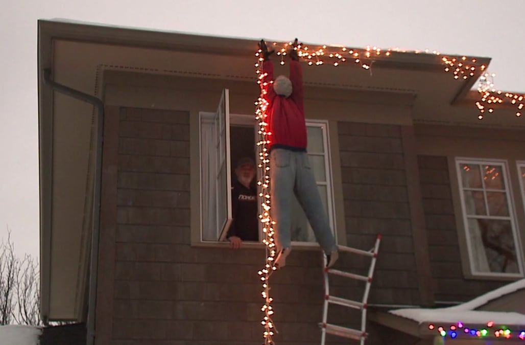 people call 911 after seeing dummy hanging christmas lights dangling from roof