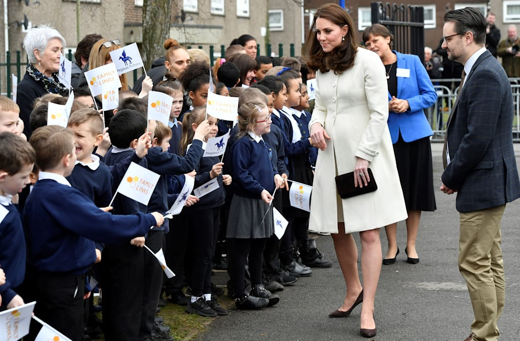 Duchess Kate recycles $140 cream maternity coat for visit to Oxford