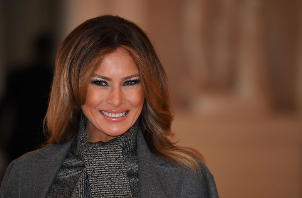 c62ae53f849b First lady Melania Trump has continued to make her own statements of  sartorial diplomacy in France this weekend