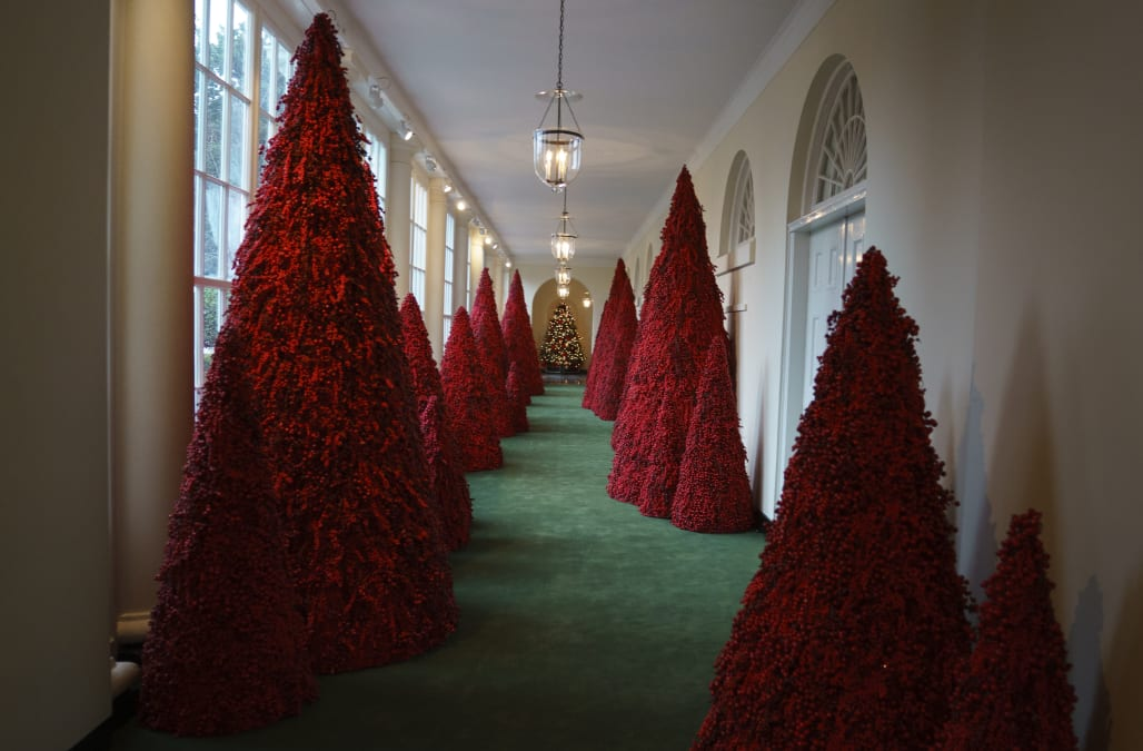 melania trump defended this years white house christmas decorations after photos of a hallway filled with all red christmas trees sparked criticism and
