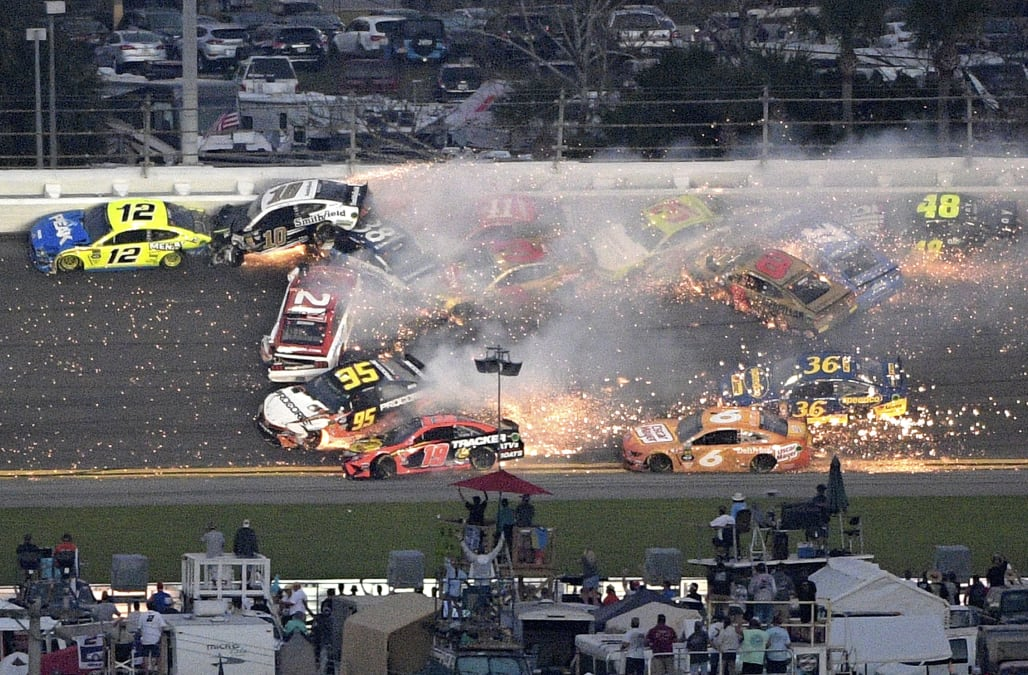 Hamlin survives multiple late wrecks to win second Daytona ...