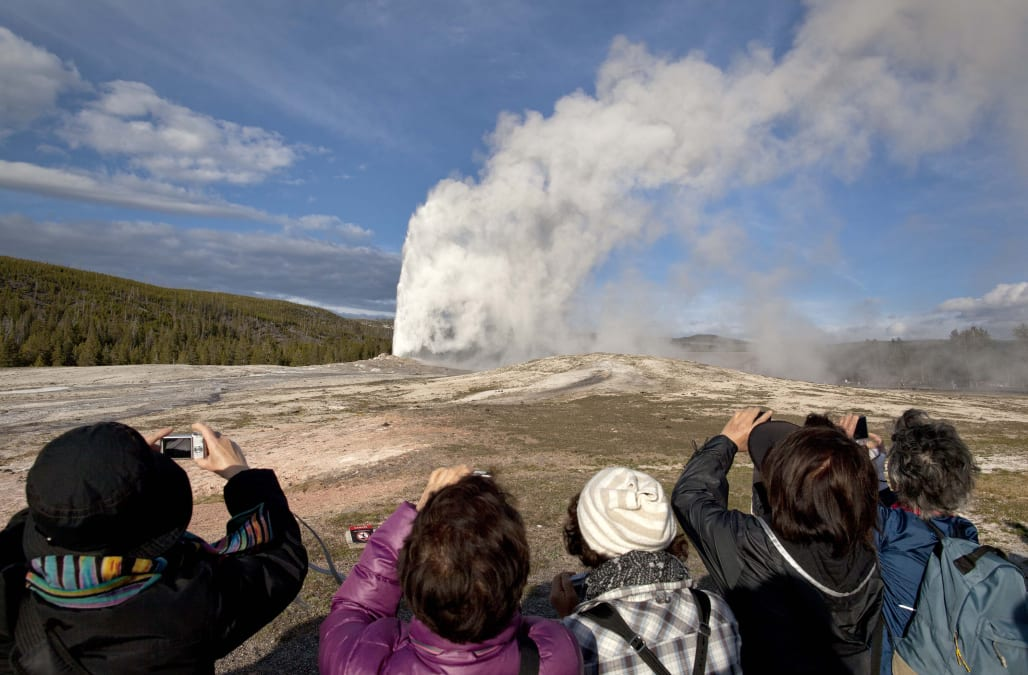 2 men face charges for walking on Old Faithful Geyser - AOL